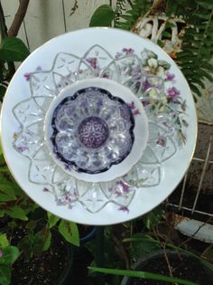 Violets, crystal and purple glass dish make a beautiful flower. MiMi's Plate Flowers