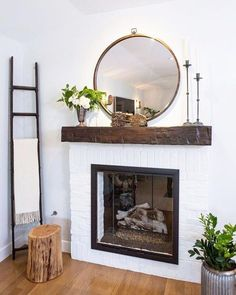 SHOP THE PIN - Hoop Mirror Anthropolgie, living room home decor ideas, minimal style and white wood house decoration Small Living Room Design, Paint Colors For Living Room, Family Room Design, Living Room Designs, Mirror Over Fireplace, Fireplace Mantle, Above Fireplace Decor, Wood Mantle, Small Fireplace