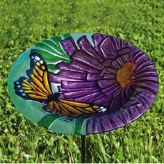 Conceived with the spirit of spring in mind, the Purple Aster Monarch Glass Birdbath is a great addition to any garden. Description from ebay.com. I searched for this on bing.com/images