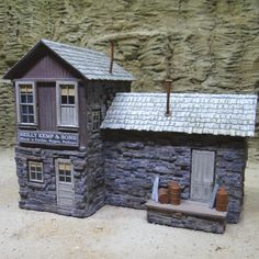There's just something special about that old rustic hand cut stone and weathered wood that makes an otherwise boring model into a real eye grabber. Add a few boarded up windows and you just can't stop looking at it like you are right now.