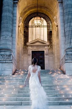 This shot of a bride gliding up a staircase surrounded by candles was captured by Christian Oth