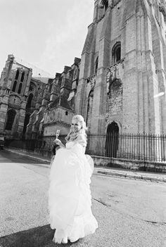 Bride, Gloria Steves, shines in this photo in front of the Notre Dam Cathedral in France! www.jwilkinsonco.com #photography #film #wedding #France