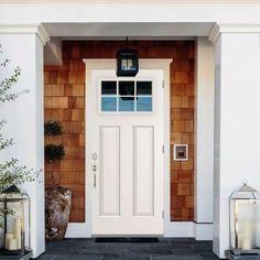 contemporary front door with ipe siding glass garage door