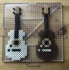 Excited to share the latest addition to my shop: Guitar Perler Beads Easy Perler Bead Patterns, Melty Bead Patterns, Perler Bead Templates, Diy Perler Beads, Bead Embroidery Patterns, Perler Bead Art, Beading Patterns, Quilt Patterns, Embroidery Jewelry