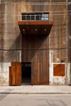 Rough Elegance: -corten steel, concrete, wood, glass--and a gorgeous palette at the Waterhouse at South Bund is a boutique hotel located in a renovated warehouse in Shanghai's old docklands. Facade Architecture, Contemporary Architecture, Neri And Hu, Marquise, Entrance Doors, Door Entry, Grand Entrance, Doorway, Cladding