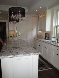 Kitchen Design, Traditional Kitchen Island Design With Alaskan White Granite Countertops Also Gorgeous And Elegant Chandeliers Design Also W...