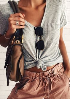 AN ABSOLUTELY 'YUMMY' LOOK, WITH KNOT TIED IN TEE, SUNNIES HANGING OFF THE NECKLINE, COOL BAG & AWESOME PANTS!! - WAY TO GO GIRL!!