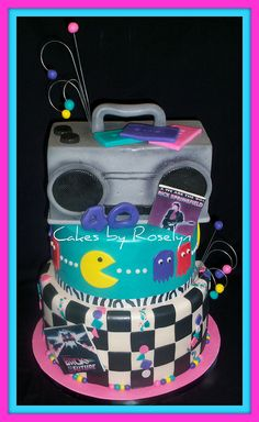 An other awesome 80's cake! Check gets mtv-pacman against black- ghostbusters on top