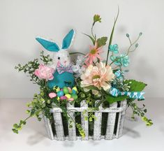 Items similar to Easter Bunny Rabbit Floral Arrangement Rustic Basket, Easter Centerpiece Table Decorations, Office Easter Spring Decorations Flowers Gift on Etsy Easter Flower Arrangements, Easter Flowers, Floral Arrangements, Types Of Flower Arrangement, Office Christmas Decorations, Spring Decorations, Table Decorations, Winter Centerpieces, Easter Centerpiece