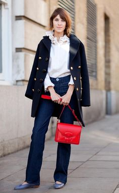 Alexa Chung channels '60s icons and punches up a navy and white look with a ladylike red bag. #classy
