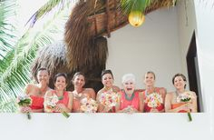 Sweet bridesmaids photographywearing turquoise and coral colors in their outfit| Tulum Weddings | www.jaimeglez.com
