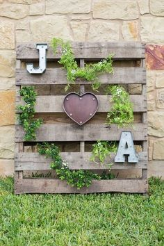 Rustic wedding sign - old, wooden palette with monogram letters and a romantic lighted heart {Julia Corinne Photography}