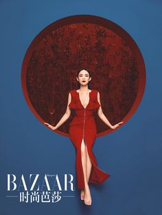 Actress Zhang Ziyi dressing in red poses for the fashion magazine.