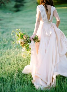 Pretty blush wedding gown: http://www.stylemepretty.com/california-weddings/agoura-hills/2016/05/19/agoura-hills-sunrise-bridal-shoot/   Photography: Samantha Kirk - http://www.samanthakirkphotography.com/
