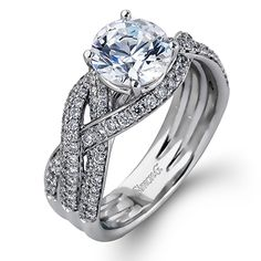 Twist Collection - This gorgeous 18K white engagement ring is comprised of .73ctw round white Diamonds.  - DR304