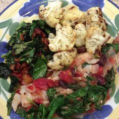 Voila! Dinner is served (halibut w/ tomatoes and olives, roasted cauliflower and collard greens with bacon)