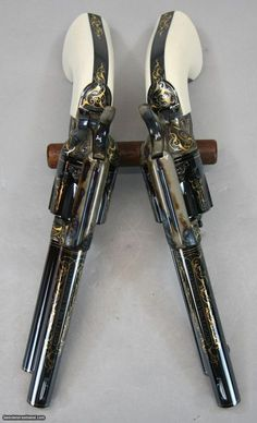 Colt Single-Action Army Revolvers, Gold Inlay and Pristine Bluing with Ivory Grips. Absolutely Gorgeous!