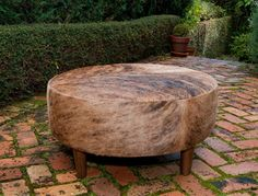A fantastic caramel round cowhide ottoman by Gorgeous Creatures who are a cowhide ottoman and leather decor specialists. www.gorgeouscreatures.co.nz or www.cowhideottoman.com.au