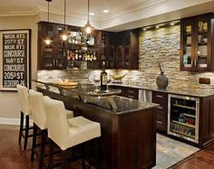 Basement Bar Idea - Love the stone, the combo of stainless steel and espresso color. Also interesting addition to the countertop. 20  Creative Basement Bar Ideas, http://hative.com/creative-basement-bar-ideas/,