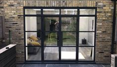 Aluminium steel replacement windows and doors give you all the benefits of modern double glazing with the look of old metal windows. French Doors Inside, Bifold French Doors, Aluminium French Doors, Aluminium Windows And Doors, French Doors Patio, French Patio, Aluminium Joinery, French Windows, Steel Doors And Windows