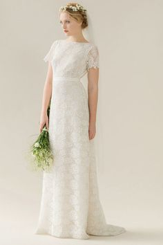 Rue de Seine   Bella   100% Guipure lace gown with an a-line silhouette, boat neck, and scalloped daisy sleeve detail. Fitted bodice with open back detail.