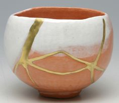 "Kintsugi (金継ぎ, meaning ""Golden Joinery"")  or Kintsukuroi (金繕い, meaning ""Golden Repair"") Kintsugi is the art of repairing broken pottery with gold or silver colored lacquered resin. The Philosophy of Kintsugi is similar to that of ""Wabi-sabi"" that things are more beautiful after they've been broken."