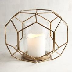 Cast candlelight on your decor with our handcrafted hurricane. Featuring an open design in wrought iron and glass, its golden finish adds a touch of glamour to your surroundings.
