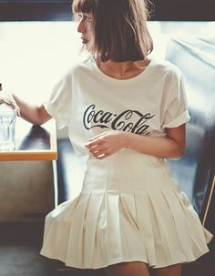 Recycle your old logo t-shirts by styling them with cute pleated skirts and Converse or cute trainers! The 90s are back :) Get started with this skirt: http://asos.do/q51M2n