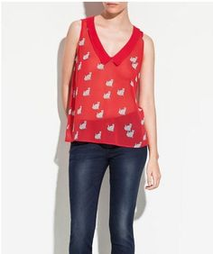 Buy Cheap Sleeveless Top Red Blouse that stands alone as essential pieces in a modern woman's closet. The color red exhibits a sense of passion and power