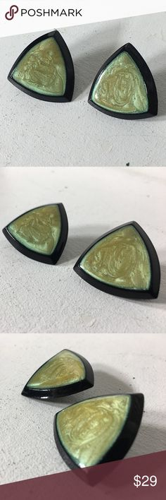 """Vintage Triangle Two Tone Clip On Earrings Fashion/Costume jewelry. Metal  Unknown. Years of purchased jewelry which has a history that I am unaware of so if you have allergies, keep that in mind. Always clean purchased jewelry.  Please ask all questions before purchasing. Good Condition.  Fading/Pealing of metal on back. Sold """"As Is"""".  Shows wear which commensurates with its age. Please remember, the pictures are your description, too, so please look at all of them. Sparkles ✨ & Happy…"""