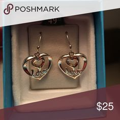 """""""Love"""" earrings These brand new silver dangle earrings feature a small heart over the word """"Love"""" inside a larger heart. From a nonsmoking home. Jewelry Earrings"""