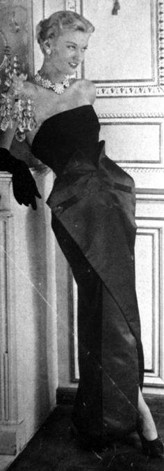 1949 / 1950 Vogue Paris model wearing Christian Dior evening gown.