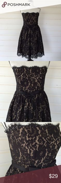 """Retro Black Lace Party Dress Nobody puts Baby in the corner! Dance the night away with Johnny Castle or the 2016 version of him. Beautifully made and well constructed. Full bra underneath, great for B to C cups. Boned bodice. Fully lined. More support would be needed for larger cups. Boutique brand. 14"""" from underarm to underarm. 13"""" at waist, 29"""" from bust to hem. Offers always warmly received. Boutique  Dresses Strapless"""