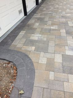 Photo of Black Diamond Paver Stones & Landscape - San Mateo, CA, United States. Belgard Catalina stone 6 pieces pattern in victorian blend with double running bond dark charcoal border,