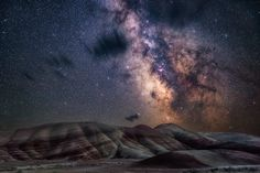 Painted Hills Nicholas Roemmelt (Germany)   With very little light pollution, the glimmering stars of the Milky Way bathe the colourful layers of the Painted Hills of Oregon in a natural glow.  Photograph: Nicholas Roemmelt/Royal Observatory Greenwich's Astronomy Photographer of the Year 2016/National Maritime Museum