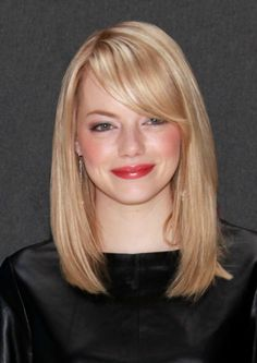 Strong, side-swept bangs like Emma Stone's turn collarbone-length hair into a polished look. This works on everyone.    - Redbook.com