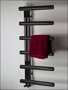 Modern designer heated towel rail in black chrome finish. The latest stylish towel rail for luxury contemporary interiors. Black Towel Rail, Chrome Towel Rail, Black Towels, Space Saving Bathroom, Small Bathroom Storage, Warm Bathroom, Bathroom Towel Rails, Towel Radiator, Towel Warmer