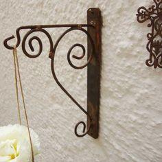 Suporte de Parede Pequeno Rococó :: Loja Dom Mascate - é de jardim mas pode servir para o mosquiteiro.
