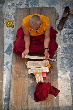 buddhabe:  qalbesaleem:  Nepal by Miro May on Flickr.  Studying the sutras.