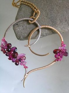 Sculptural Heart...Signature Original Sculptural Mixed Metal Stylized Heart Pendant w/red and magenta hued gemstones.
