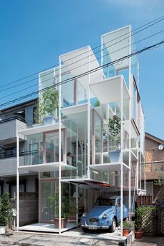Cubes. This is a home! House NA by Sou Fujimoto (2010)  Sou Fujimoto designed this multi-level home to recreate the experience of clambering up the branches of a tree. The steel and glass lattice encapsulates twenty-one small spaces at varying levels.