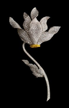 A Fine 18 Karat Gold, Colored Diamond and Diamond Flower Brooch, Ambrosi, in white gold with yellow gold accent, consisting of a blossom composed of five unfurling petals pave set with 516 round brilliant cut diamonds weighing approximately 25.80 carats total and 12 round brilliant cut yellow diamonds (origin of color not tested) weighing approximately 0.36 carat total, extending to the stylized stem and leaf containing 105 round brilliant cut diamonds weighing approximately 5.20 carats…