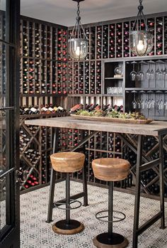 Beautiful Industrial-farmhouse wine room with patterned tile. The patterned tile is Mediterranean 26 tile from Tabarka Studio. Barstools are Caymus Bar Stools from Arteriors. Pendants are Clifton Pendant from Currey and Company. Table is custom made. Wine Rack Design, Wine Cellar Design, Wine Cellar Modern, Wine Rack Furniture, Bar Furniture, Dark Room Photography, Wine Cellar Basement, Home Wine Cellars, Wine Tasting Room