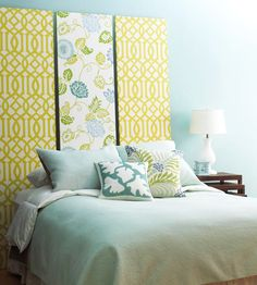 Complementary Panels  Choose two wallpaper patterns to create a personalized do-it-yourself headboard for your bed. Hang one strong wallpaper for the center panel and select a subtler pattern for the flanking panels. Here, a green-and-white pattern is the perfect complement to a striking floral green, white, and blue design.