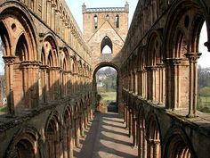 The nave of Jedburgh Abbey church, remarkably well preserved despite repeated conflict.