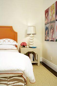 Massucco Warner Miller - bedrooms - orange headboard, orange linen headboard,  Orange headboard with nailhead trim, rug, art, and white lamp.