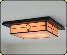 Morris Mission kitchen ceiling light. Comes in the soft amber glass or a brighter/whiter glass.