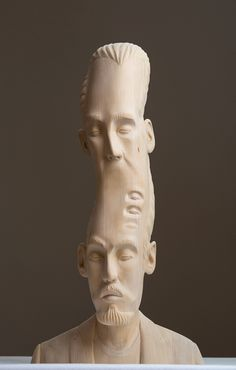 Eeceecajpg Figurative Sculpture - Taiwanese artist creates wooden sculptures that look like digital glitches