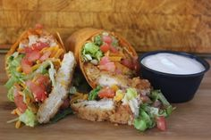 Buffalo Chicken Wrapper: Deep-fried Breaded Chicken mixed with Spicy Buffalo Wing Sauce, Lettuce, Ripe Tomatoes, Cheddar Cheese and our Homemade Ranch Dressing. Delish~