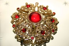 Vintage Large Gold Coloured & Red Diamantes Star by GillardAndMay